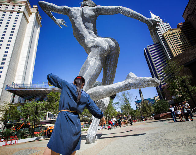 "Mora Rojas from Guatemala strikes a poise similar to the ""Bliss Dance"" statue at The Park on Tuesday, April 5, 2016. Jeff Scheid/Las Vegas Review-Journal Follow @jlscheid"