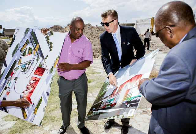 Architect Edward Vance, center, discusses the proposed new Moulin Rouge Las Vegas while Scott Johnson, left, president of Moulin Rouge Holdings, and Gene Collins, vice president of Moulin Rouge Ho ...