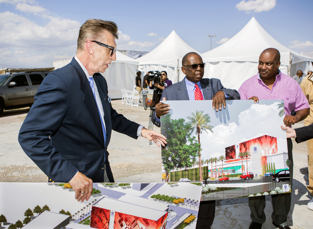 Architect Edward Vance, left, discusses the proposed new Moulin Rouge Las Vegas while Gene Collins, center, vice president of Moulin Rouge Holdings and Scott Johnson, president of Moulin Rouge Hol ...