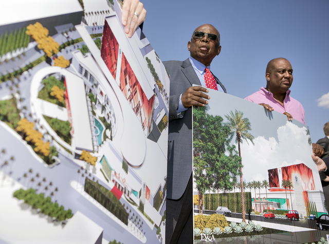 Gene Collins, left, vice president of Moulin Rouge Holdings and Scott Johnson, president of Moulin Rouge Holdings, holds a rendering during a ground breaking at the original Moulin Rouge site at 9 ...