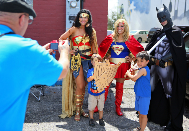 From left, Lara Duffin, dressed as Wonder Woman, stands with Ben Foster, 3; Tia Golden, dressed as Supergirl; Joe Foster, 5, and Cody Strohl, dressed as Batman, for a personal photograph during a  ...