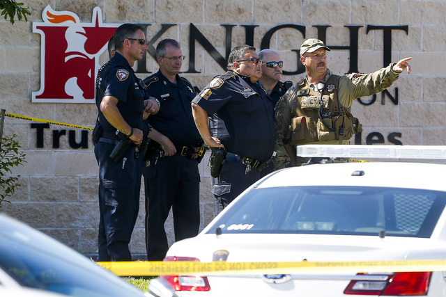 Sheriff's deputies surround Knight Transportation after an employee, who was recently fired, returned to the business and fatally shot an employee before killing himself, Wednesday, May 4, 2016, i ...