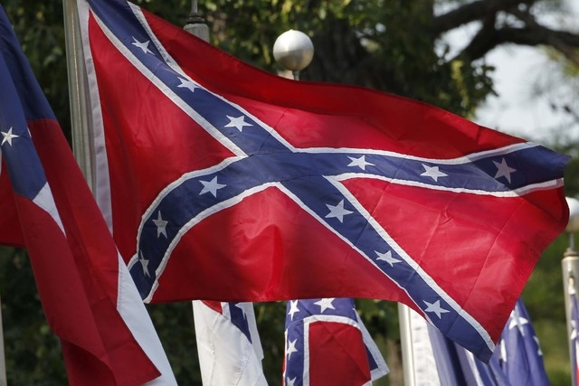 Confederate battle flags fly in Mountain Creek, Ala., July 19, 2011 The House has voted to ban the display of the Confederate flag on flagpoles at Veterans Administration cemeteries. (Dave Martin/AP)