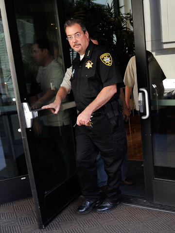 Las Vegas Constable John Bonaventura, left, exits his downtown offices as Las Vegas police look on Tuesday, June 17, 2014. (David Becker/Las Vegas Review-Journal)