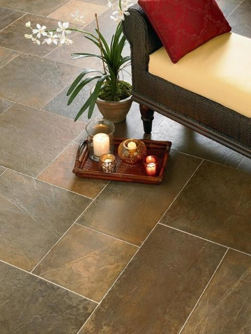 COURTESY Large porcelain tile means less grout to clean while at the same time helping to create a more spacious look to your room.