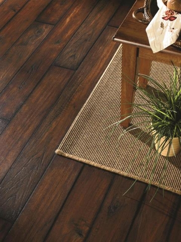 COURTESY Luxury vinyl and porcelain tile can take on the look of hardwood flooring.