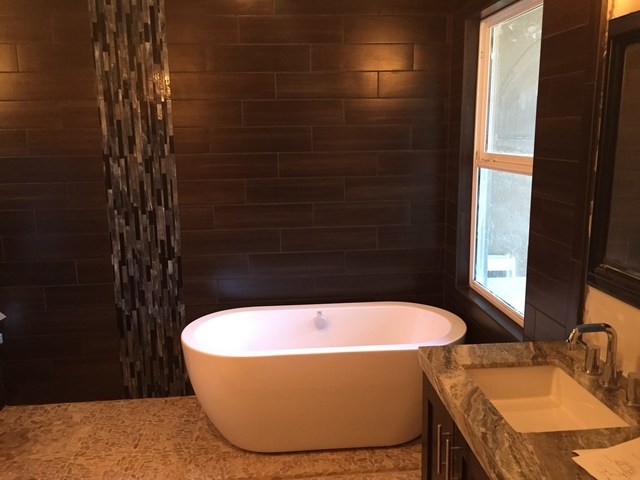 COURTESY LAS VEGAS REMODEL AND CONSTRUCTION Contemporary freestanding tubs have evolved and are available in a large variety of sizes, shapes, styles and materials.