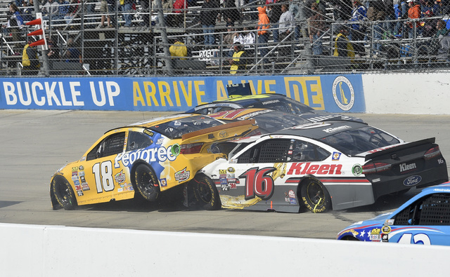 The car of Kyle Busch (18) is plowed into by Greg Biffle (16) as Jimmie Johnson (48) continues to wreck along with Ryan Newman, center, during the NASCAR Sprint Cup series auto race, Sunday, May 1 ...