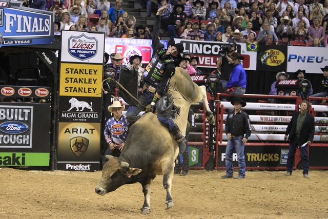 J.B. Mauney rides Bruiser to the best score of the night, a 93.25, during the fourth round of the PBR World Finals Saturday, Oct. 25, 2015 at the Thomas & Mack Center.  The 21st edition of the ...