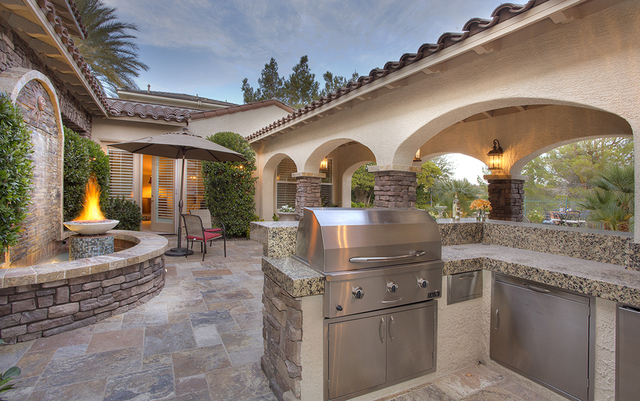 The outdoor kitchen on the patio in the home at 11856 Brigadoon Drive in Southern Highlands. (Synergy, Sotheby's International Realty)