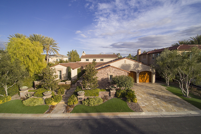 The home at 11856 Brigadoon Drive in Southern Highlands is near the golf course. (Synergy, Sotheby's International Realty)