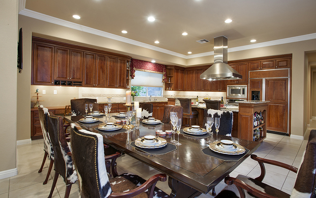 The kitchen and dining room at the home at 11856 Brigadoon Drive in Southern Highlands. (Synergy, Sotheby's International Realty)