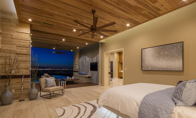 The showcase home's master suite opens to the pool area. (Courtesy Sun West Custom Homes)