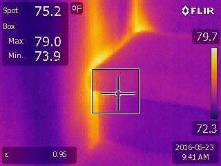COURTESY Thermal imaging shows air leakage around these stairs.