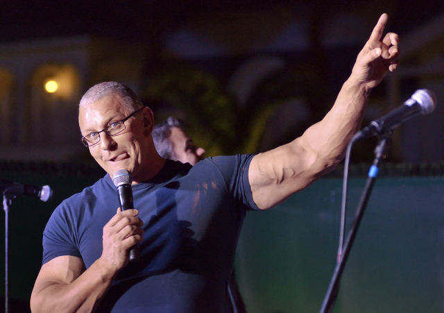 Chef Robert Irvine makes a face while describing what it was like to rappel down the side of the Tropicana hotel-casino during an announcement that he will open a new restaurant at the property at ...