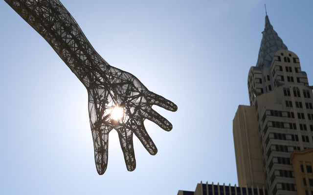 "The morning sun's rays pierce the ""Bliss Dance"" sculpture at The Park near T-Mobile Arena on the Las Vegas Strip, Wednesday, May 11, 2016. (Bizuayehu Tesfaye/Las Vegas Review-Journal Follow @bizut ..."