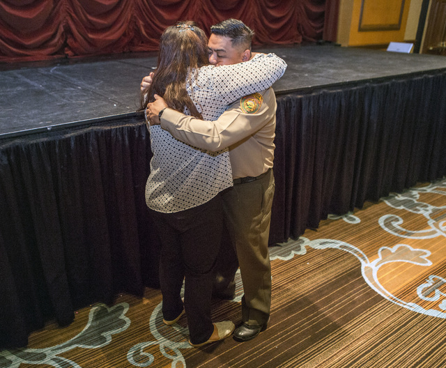Department of Correction officer Patrick Mercado hugs his wife Marigold after graduation Friday, May 6, 2016, at Texas Station Hotel and Casino, 2101 Texas Star Lane.  (Jeff Scheid/Las Vegas Revie ...