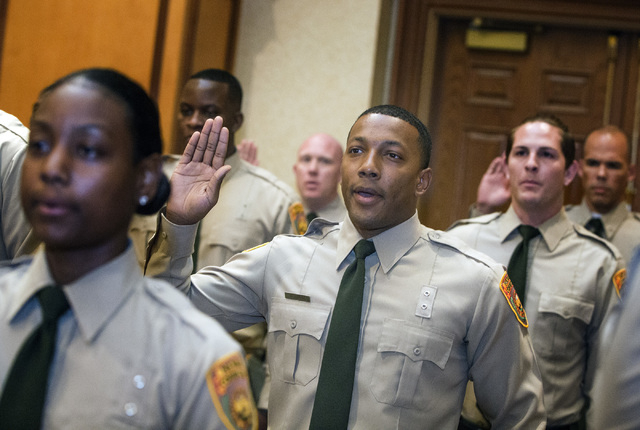 Department of Correction officer Daniel Horne takes the oath of office Friday, May 6, 2016, during graduation at Texas Station Hotel and Casino, 2101 Texas Star Lane.  (Jeff Scheid/Las Vegas Revie ...