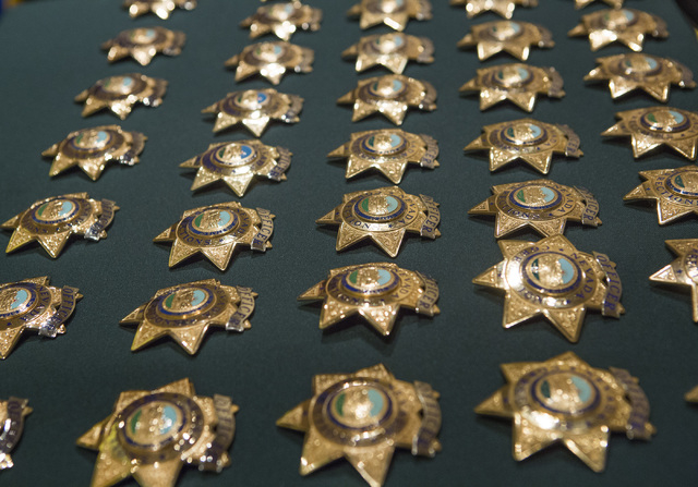 Rows of Department of Correction officer badges is Friday, May 6, 2016, during graduation at Texas Station Hotel and Casino, 2101 Texas Star Lane.  (Jeff Scheid/Las Vegas Review-Journal) Follow @j ...
