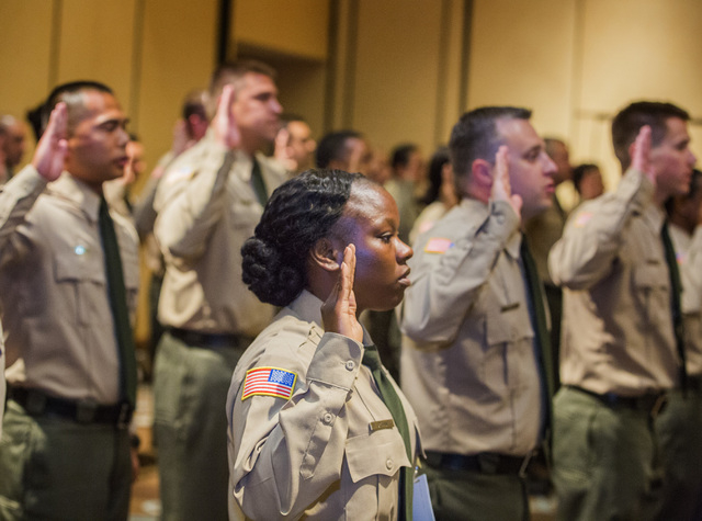 Department of Correction officer D'vesheia Crowell takes the oath of office Friday, May 6, 2016, during graduation at Texas Station Hotel and Casino, 2101 Texas Star Lane. (Jeff Scheid/Las Vegas R ...