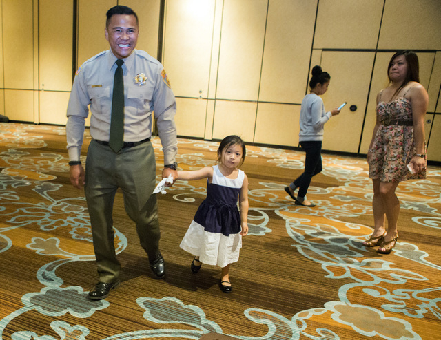 Department of Correction officer John Vegas holds his daughter Mia, 3, after graduating Friday, May 6, 2016 at Texas Station Hotel and Casino, 2101 Texas Star Lane. (Jeff Scheid/Las Vegas Review-J ...