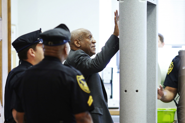 Comedian Bill Cosby touches the metal detector after bumping into it as he arrives at the Montgomery County Courthouse for a preliminary hearing related to assault charges, May 24, 2016, in Norris ...