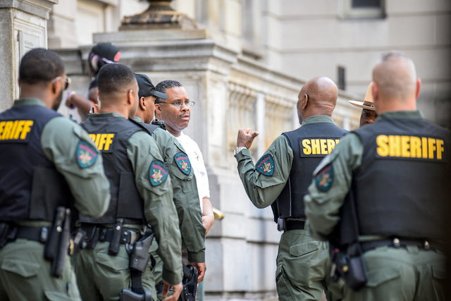 A heavy police presence surrounds a courthouse during the trial of police officer Edward Nero in connection with the death of Freddie Gray in Baltimore, Maryland, U.S., May 23, 2016. (Bryan Woolst ...