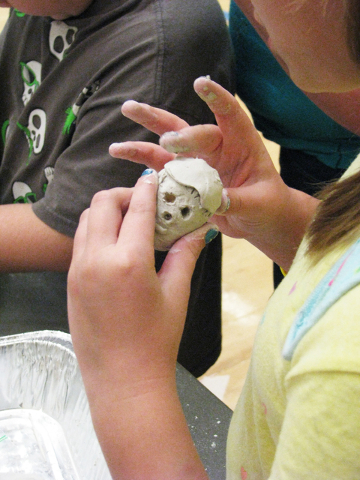 A student applies clay to a small plastic skull at the Crimebusters! event  May 2, 2016, at the Veterans Tribute Career Technical Academy, 2531 Vegas Drive. F. Andrew Taylor/View