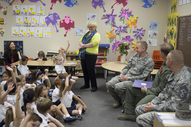 Kindergarten students at The Meadows School enjoy a visit May 10, 2016, from Creech Air force Base airmen. From left are teacher Ms. Verbon, Col. Cunningham, Col. Chittenden and Chief Ditore. Stud ...
