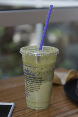 Brain tumor survivor, Danny Efron's green tea based drink is seen as Efron speaks with a reporter at The Coffee Bean & Tea Leaf in Town Square in Las Vegas Wednesday, May 4, 2016. Green tea he ...
