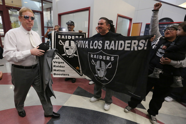 Oakland Raiders owner Mark Davis walks past fans during a Southern Nevada Tourism Infrastructure Committee meeting at UNLV in Las Vegas on Thursday, April 28, 2016. (Brett Le Blanc/Las Vegas Revie ...