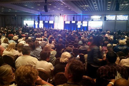 Thousands of people gather at the Paris casino in Las Vegas for the Nevada State Democratic Convention on Saturday, May 14, 2016. They are picking delegates to send to the national convention in J ...