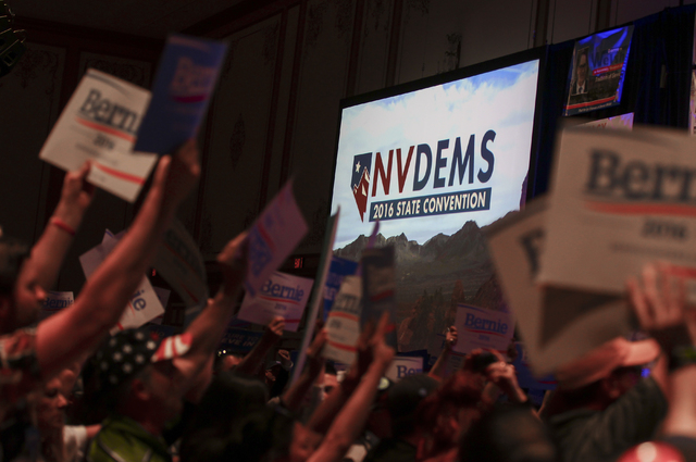 Supporters of Democratic presidential candidate Bernie Sanders crowd the front of the room during the Nevada State Democratic Party's 2016 State Convention at the Paris hotel-casino in Las Vegas o ...