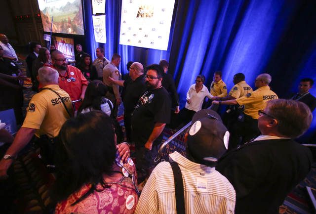 Supporters of Democratic presidential candidate Bernie Sanders crowd around as U.S. Sen. Barbara Boxer, D-Calif., is escorted out during the Nevada State Democratic Party's 2016 State Convention a ...