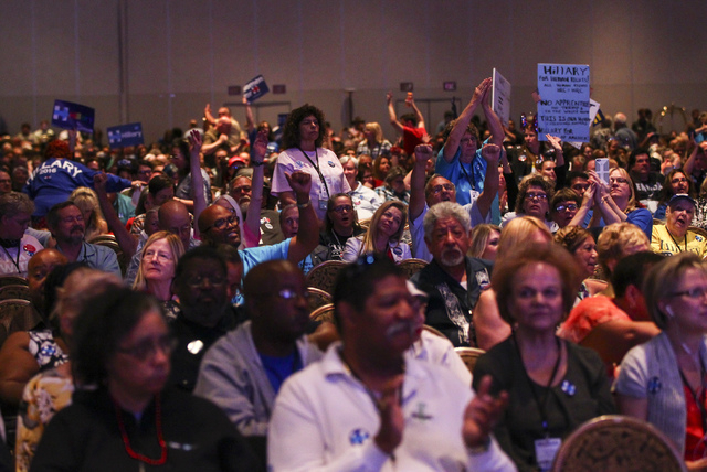 Supporters of Democratic presidential candidate Hillary Clinton cheer during the Nevada State Democratic Party's 2016 State Convention at the Paris hotel-casino in Las Vegas on Saturday, May 14, 2 ...