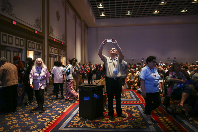 Attendees walks around during the Nevada State Democratic Party's 2016 State Convention at the Paris hotel-casino in Las Vegas on Saturday, May 14, 2016. (Chase Stevens/Las Vegas Review-Journal) F ...