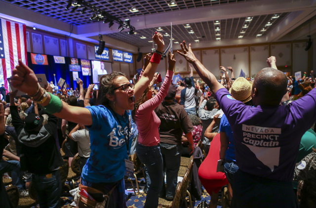 Supporters of Democratic presidential candidate Bernie Sanders react during the Nevada State Democratic Partyճ 2016 State Convention at the Paris hotel-casino in Las Vegas on Saturday, May 1 ...