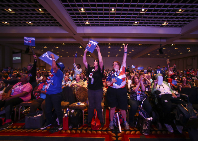 Supporters of Democratic presidential candidate Hillary Clinton react as a video is played during the Nevada State Democratic Party's 2016 State Convention at the Paris hotel-casino in Las Vegas o ...