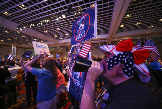 """Matthew Gibmeyer, right, chants """"this is fixed"""" with supporters of Democratic presidential candidate Bernie Sanders during the Nevada State Democratic Party's 2016 State Convention at the Paris ho ..."""