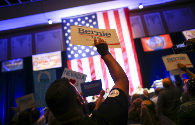"""Supporters of Democratic presidential candidate Bernie Sanders chant """"no confidence"""" and """"this is fixed"""" during the Nevada State Democratic Party's 2016 State Convention at the Paris hotel-casino  ..."""