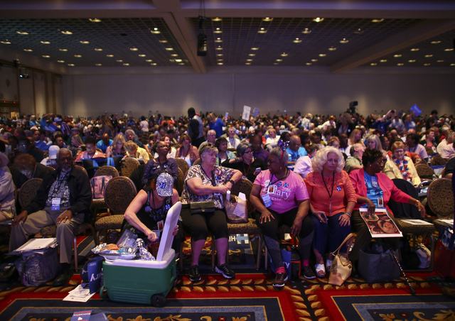 Supporters of Democratic presidential candidate Hillary Clinton talk with one another during the Nevada State Democratic Party's 2016 State Convention at the Paris hotel-casino in Las Vegas on Sat ...