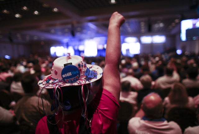 A supporter of Democratic presidential candidate Hillary Clinton reacts during the Nevada State Democratic Party's 2016 State Convention at the Paris hotel-casino in Las Vegas on Saturday, May 14, ...