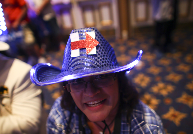 Lois Esparza, wearing a decorated hat supporting Democratic presidential candidate Hillary Clinton, poses for a photo during the Nevada State Democratic Party's 2016 State Convention at the Paris  ...