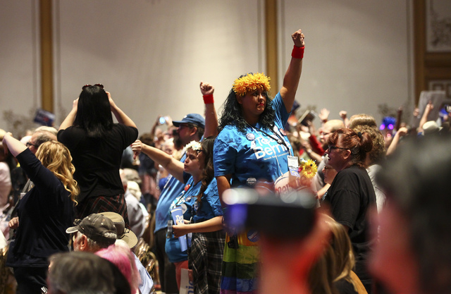 Supporters of Democratic presidential candidate Bernie Sanders react during the Nevada State Democratic Party's 2016 State Convention at the Paris hotel-casino in Las Vegas on Saturday, May 14, 20 ...