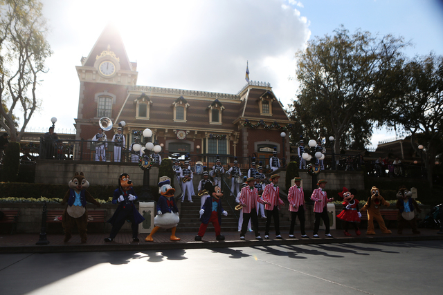 Disneyland characters and other entertainers sing a song at Disneyland on Wednesday, Dec. 23, 2015 in Anaheim, Calif. Erik Verduzco/Las Vegas Review-Journal Follow @Erik_Verduzco
