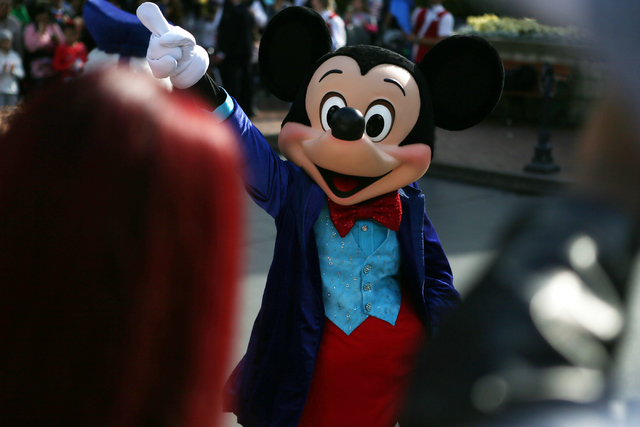 Mickey Mouse entertains the crowd at Disneyland on Wednesday, Dec. 23, 2015 in Anaheim, Calif. Erik Verduzco/Las Vegas Review-Journal Follow @Erik_Verduzco