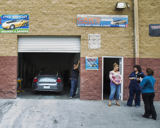 Left/Right: Car's Concepts owner Jose Orellana is forced to close his shop after being issued a citation for operating a garage without a license, while his wife speaks with compliance investigato ...