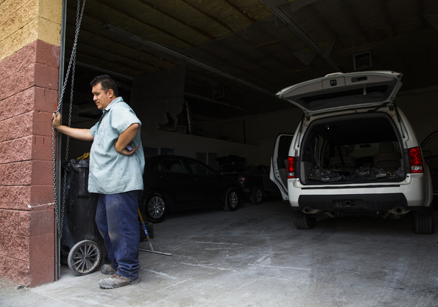 Jose Tinoco stands by the door of his garage after being cited by the Nevada Department of Motor Vehicles for operating an auto body shop without a license, Tuesday, May 17, 2016, in Las Vegas. Be ...