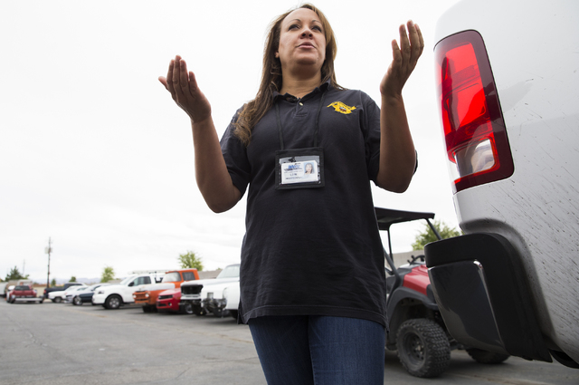 Lori Billingsley, a supervisor compliance investigator with the Nevada Department of Motor Vehicles, explains a citation her team issued to the owner of TKO Kustumz for operating an unlicensed rep ...