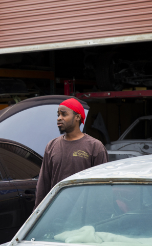 The owner of TKO Kustumz stands outside his auto body shop after being cited by investigators from the Nevada Department of Motor Vehicles for not having a license to operate, Tuesday, May 17, 201 ...
